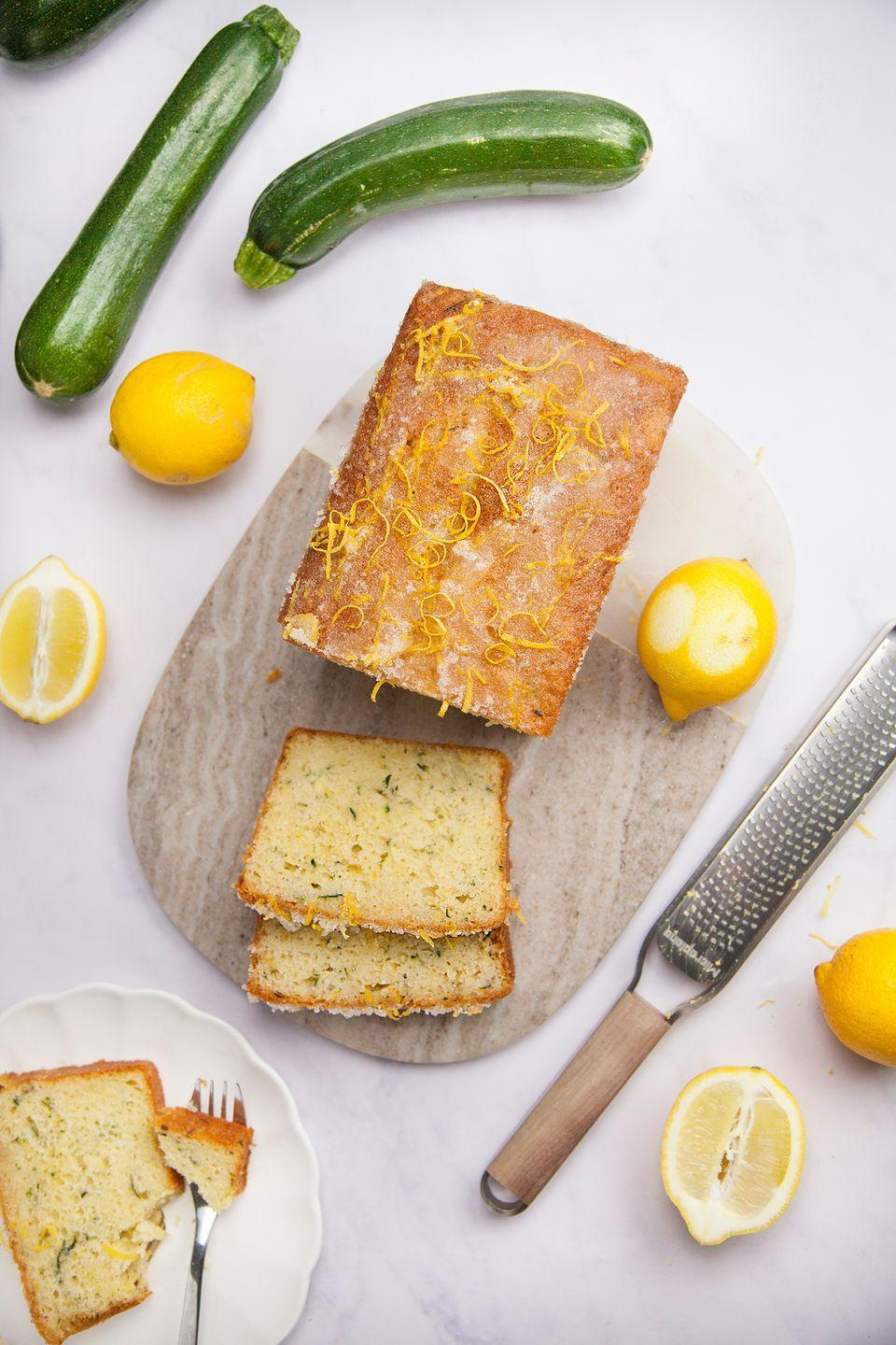 """<p>We've transformed the humble lemon drizzle, one of the nation's favourite bakes, into a gorgeous courgette-filled cake. Yep, courgette gives a bake lovely moisture - and you're sure to love this.</p><p><strong>Recipe: <a href=""""https://www.goodhousekeeping.com/uk/food/recipes/a25915707/courgette-lemon-drizzle-cake/#"""" rel=""""nofollow noopener"""" target=""""_blank"""" data-ylk=""""slk:Courgette Lemon Drizzle Cake"""" class=""""link rapid-noclick-resp"""">Courgette Lemon Drizzle Cake</a></strong></p>"""