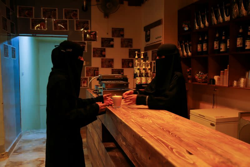 A woman makes an order at the only all-female internet cafe in Marib