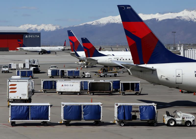 Delta Airlines planes are loaded and unloaded at Salt Lake City International Airport in Salt Lake City