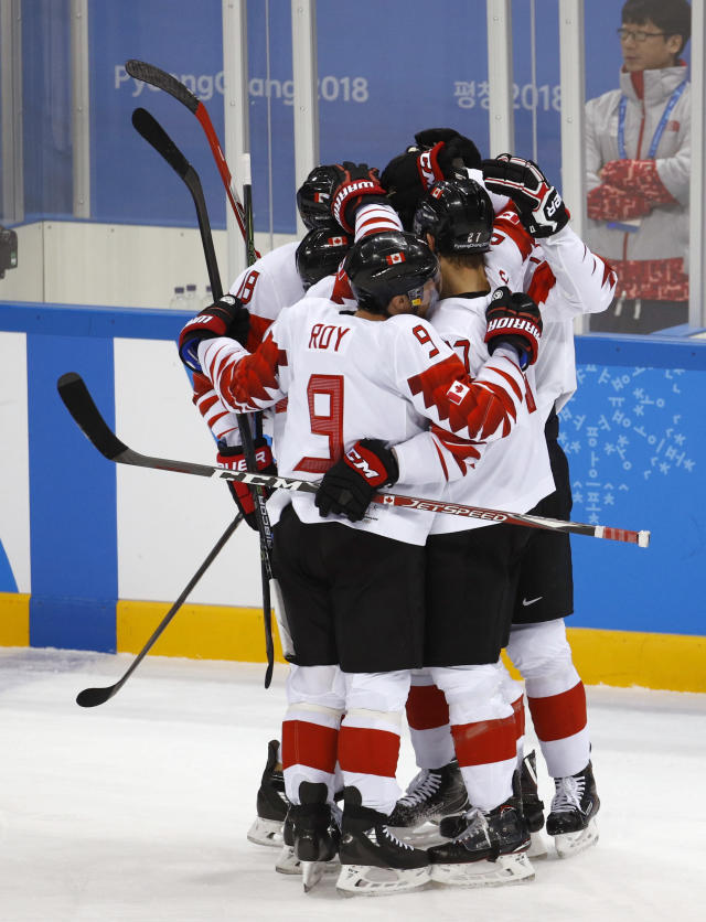 Derek Roy (9), of Canada, celebrates with his teammates after scoring a goal against the Czech Republic during the first period of the men's bronze medal hockey game at the 2018 Winter Olympics in Gangneung, South Korea, Saturday, Feb. 24, 2018. (AP Photo/Charlie Riedel)