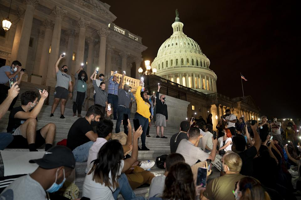 Alexandria Ocasio-Cortez, Jamaal Bowman, Cori Bush,  Sara Jacobs, a Democrat from California, and Jim McGovern, a Democrat from Massachusetts, participate in a protest against the expiration of the eviction moratorium outside of the U.S. Capitol in Washington, D.C., U.S., on Sunday, Aug. 1, 2021. (Stefani Reynolds/Bloomberg via Getty Images)