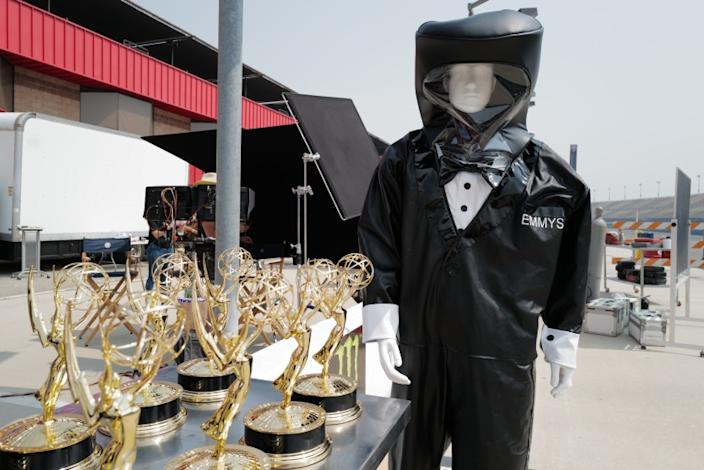 """72ND EMMY® AWARDS - A mannequin in a tuxedo hazmat suit guards over the Emmy statuettes in preparation for the """"72nd Emmy® Awards."""""""