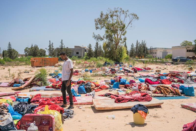 A man stands near damaged belongings after an airstrike hit a detention center, killing 53 people and injuring about 130 people, near Tripoli on July 3, 2019.   Emanuele Satolli
