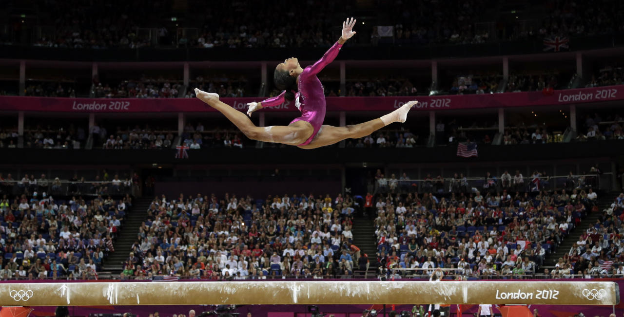 In this Thursday, Aug. 2, 2012 photo, U.S. gymnast Gabrielle Douglas performs on the balance beam during the artistic gymnastics women's individual all-around competition at the 2012 Summer Olympics, in London. (AP Photo/Gregory Bull)