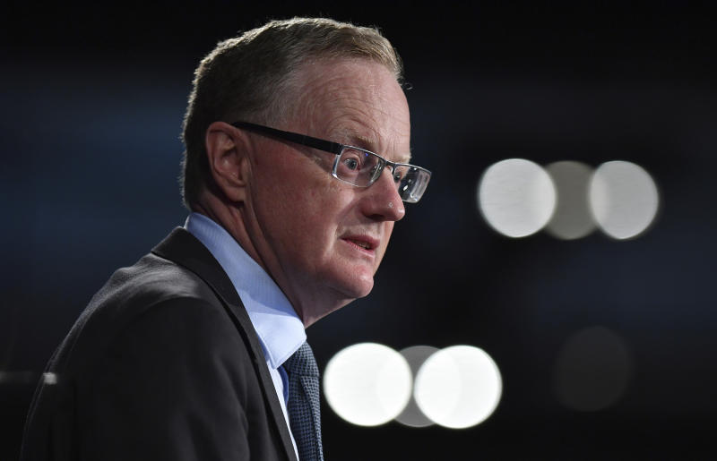 Reserve Bank of Australia Governor Philip Lowe addresses the National Press Club in Sydney, Wednesday, Feb. 5, 2020. The wildfires will slow growth by 0.2 percentage points in the six months through March, Lowe told the National Press Club. (Joel Carrett/AAP Image via AP)