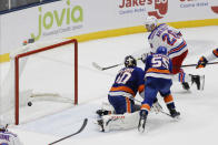 New York Rangers' Chris Kreider (20) shoots the puck past New York Islanders goaltender Semyon Varlamov (40) and Johnny Boychuk (55) for the game winning goal during the third period of an NHL hockey game Thursday, Jan. 16, 2020, in Uniondale, N.Y. The Rangers won 3-2. (AP Photo/Frank Franklin II)