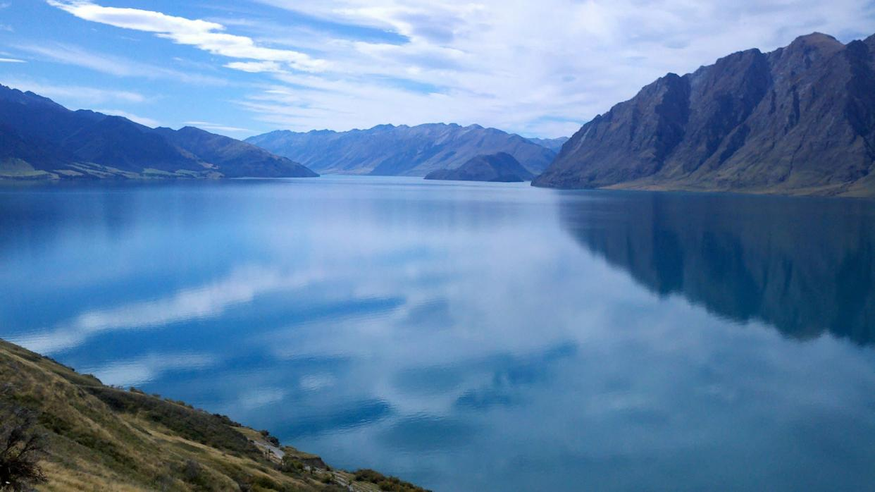 &quot;This is Lake Wanaka in New Zealand, where I pilgrimaged for re-grounding after a very chaotic and emotional period of my life. The lake reflects the sky and all the earth around it, creating a timeless and spaceless effect. Gazing upon the water, filled with compassion for myself and others, I experienced infinity. I felt intimately connected to everything around me, and embraced a deep sense of peace that Nature always, eventually, finds ways to heal herself.&quot; --<strong>Antonia Blumberg, Associate Religion Editor</strong>