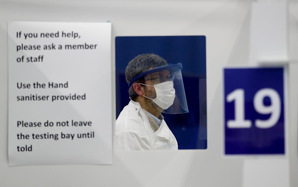 An employee attends testing of a lateral flow antigen test facility, amid the spread of the coronavirus disease (COVID-19), in St Andrews, Scotland, Britain, November 27, 2020. REUTERS/Russell Cheyne