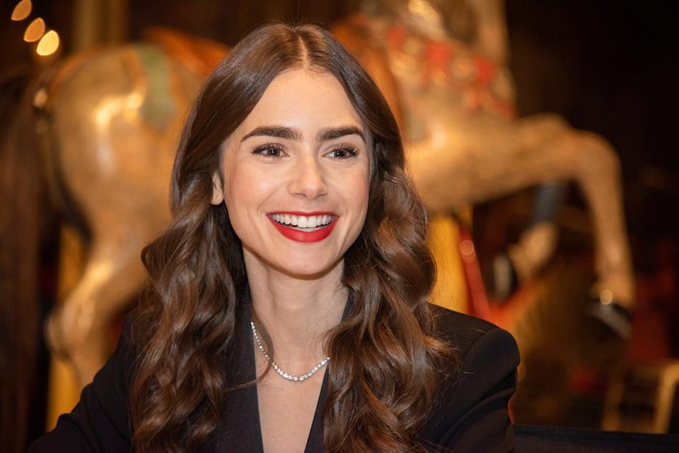 """PARIS, FRANCE - SEPTEMBER 27: Lily Collins at the """"Emily In Paris"""" Set Visit at Museo Des Arts Foraine on September 27, 2019 in Paris, France. (Photo by Vera Anderson/WireImage)"""