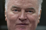 FILE — In this Wednesday, Nov. 22, 2017 file photo, Bosnian Serb military chief Ratko Mladic enters the Yugoslav War Crimes Tribunal in The Hague, Netherlands, to hear the verdict in his genocide trial. U.N. judges on Tuesday, June 8, 2021 deliver their final ruling on the conviction of former Bosnian Serb army chief Radko Mladic on charges of genocide, war crimes and crimes against humanity during Bosnia's 1992-95 ethnic carnage. Nearly three decades after the end of Europe's worst conflict since World War II that killed more than 100,000 people, a U.N. court is set to close the case of the Bosnian War's most notorious figure. (AP Photo/Peter Dejong, Pool, File)