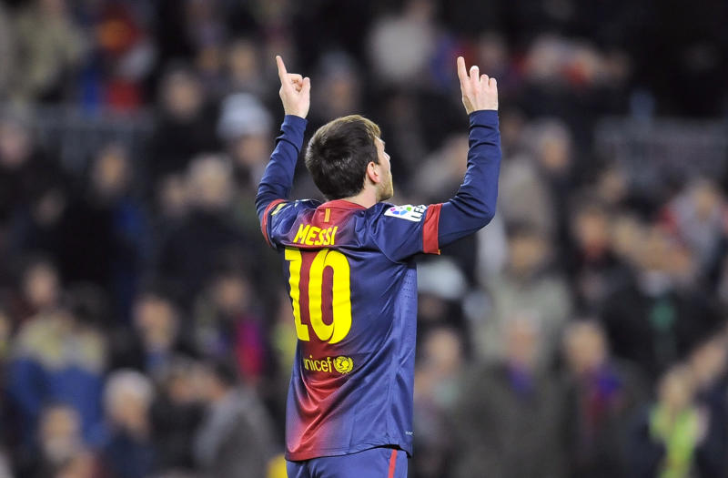 Barcelona's Lionel Messi from Argentina, right, celebrates after scored against Osasuna during their Spanish League soccer match, at Camp Nou stadium in Barcelona, Spain, Sunday, Jan. 27, 2013. (AP Photo/Alvaro Barrientos)