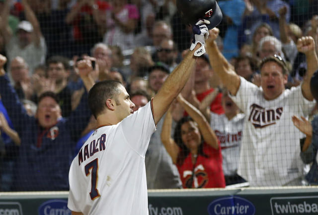 Joe Mauer will think about his future during the offseason. (AP Photo/Jim Mone)