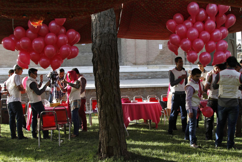 Afghans prepare some of the 10,000 pink balloons handed out by artists and activists in Kabul, Afghanistan, Saturday, May, 25, 2013. The project brought smiles to surprised Afghans on the street a day after a major Taliban siege on an international compound.(AP Photo/Ahmad Jamshid)