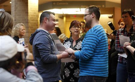 Isaac Troyo (L) and his partner Jed Mecham get married at the Salt Lake County Government Building in Salt Lake City, Utah, December 23, 2013. REUTERS/Jim Urquhart