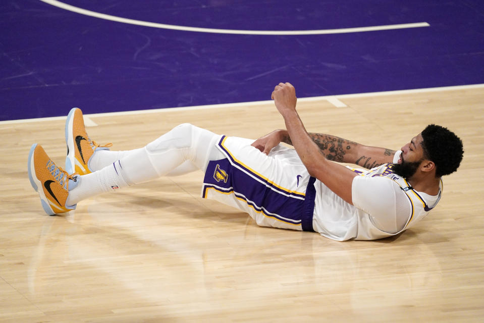 Los Angeles Lakers forward Anthony Davis takes a fall during the second half in Game 4 of an NBA basketball first-round playoff series against the Phoenix Suns Sunday, May 30, 2021, in Los Angeles. (AP Photo/Mark J. Terrill)
