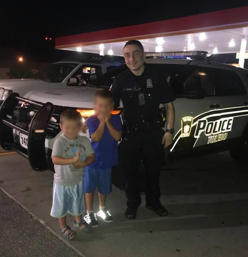 Officer Anthony Dia poses with two children hours before being killed. Source: Facebook