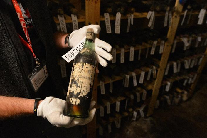 Tomas Wizovsky, castellan at the Becov castle, shows a bottle of a 19th-century wine at the cellar of the castle in Becov nad Teplou in Czech Republic's Western Bohemia (AFP Photo/Michal Cizek)