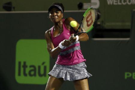 Mar 30, 2017; Miami, FL, USA; Venus Williams of the United States hits a backhand against Johanna Konta of Great Britain (not pictured) in a women's singles semi-final during the 2017 Miami Open at Crandon Park Tennis Center Mandatory Credit: Geoff Burke-USA TODAY Sports