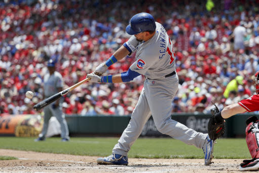 Chicago Cubs' Kyle Schwarber hits a two-run home run off Cincinnati Reds starting pitcher Tyler Mahle in the second inning of a baseball game, Sunday, May 20, 2018, in Cincinnati. (AP Photo/John Minchillo)