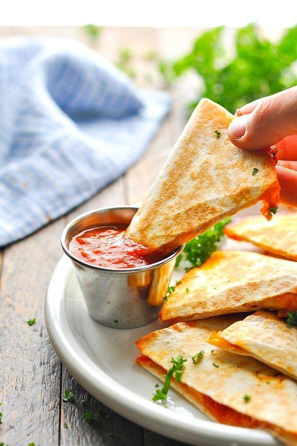"""<p>Your children will love these quesadillas because of their delicious pizza filling, but you'll love them because they only use three basic ingredients.</p><p><strong>Get the recipe at <a href=""""https://www.theseasonedmom.com/cooking-kids-series-pizzadillas/"""" rel=""""nofollow noopener"""" target=""""_blank"""" data-ylk=""""slk:The Seasoned Mom"""" class=""""link rapid-noclick-resp"""">The Seasoned Mom</a>.</strong></p><p><strong><a class=""""link rapid-noclick-resp"""" href=""""https://www.amazon.com/Lodge-Griddle-Pre-seasoned-Pancakes-Quesadillas/dp/B00008GKDN/?tag=syn-yahoo-20&ascsubtag=%5Bartid%7C10050.g.4772%5Bsrc%7Cyahoo-us"""" rel=""""nofollow noopener"""" target=""""_blank"""" data-ylk=""""slk:SHOP PANS"""">SHOP PANS</a><br></strong></p>"""