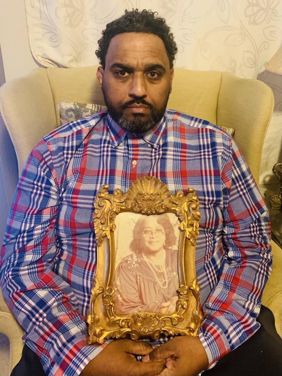 Christopher Pendergrass holds a photo of his beloved grandmother, Viola.