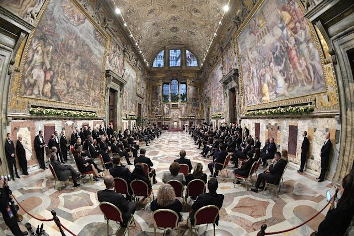 Pope Francis (background) speaks to an audience with 27 heads of State or government at the Vatican, on March 24, 2017 (AFP Photo/HO)