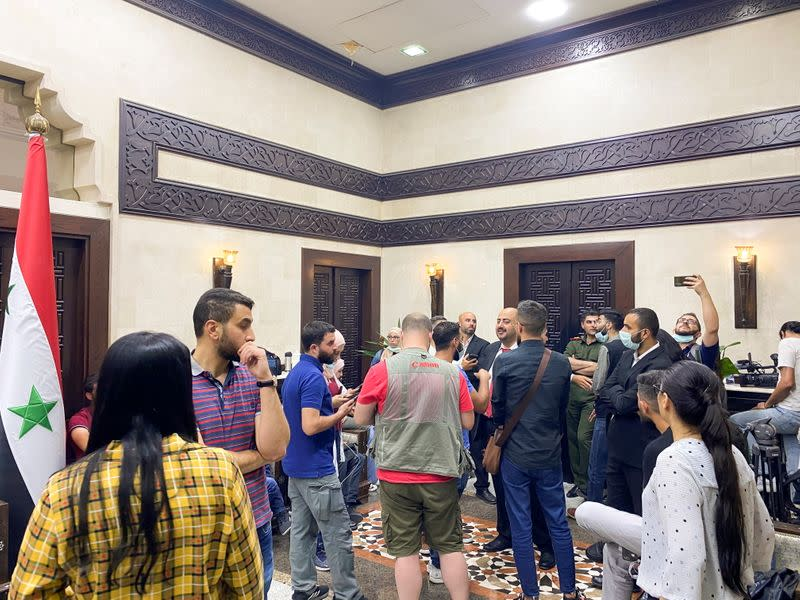 Journalists wait in a hall before the announcement of the Syrian presidential election results, at the Syrian parliament building in Damascus