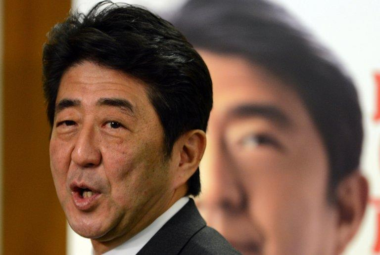 Japan's Liberal Democratic Party (LDP) leader Shinzo Abe, pictured after a press conference at the LDP headquarters in Tokyo, on December 17, 2012. Abe will send a special envoy to China on a fence-mending trip, a report said on Saturday, after he announced plans to dispatch an emissary on a similar mission to South Korea