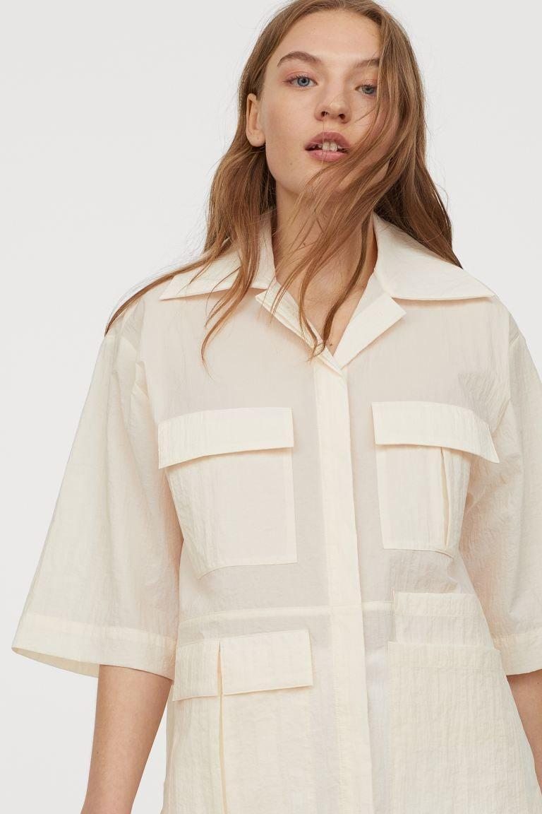 "<p>This <a href=""https://www.popsugar.com/buy/HampM-Nylon-Utility-Shirt-580551?p_name=H%26amp%3BM%20Nylon%20Utility%20Shirt&retailer=www2.hm.com&pid=580551&price=40&evar1=fab%3Aus&evar9=47523854&evar98=https%3A%2F%2Fwww.popsugar.com%2Ffashion%2Fphoto-gallery%2F47523854%2Fimage%2F47538045%2FHM-Nylon-Utility-Shirt&list1=shopping%2Ch%26m%2Csummer%20fashion%2Cfashion%20shopping&prop13=mobile&pdata=1"" class=""link rapid-noclick-resp"" rel=""nofollow noopener"" target=""_blank"" data-ylk=""slk:H&amp;M Nylon Utility Shirt"">H&amp;M Nylon Utility Shirt</a> ($40) looks so luxe.</p>"
