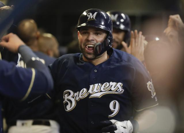Milwaukee Brewers' Manny Pina is congratulated after hitting a three-run home run during the sixth inning of a baseball game against the Cincinnati Reds Wednesday, Sept. 19, 2018, in Milwaukee. (AP Photo/Morry Gash)