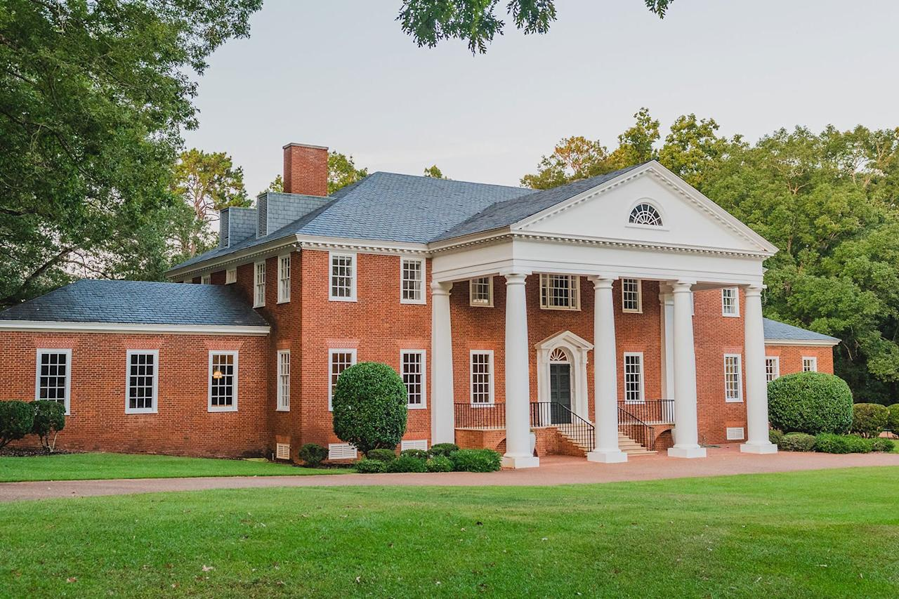 <p>Tuscan columns support the home's grand portico.</p>
