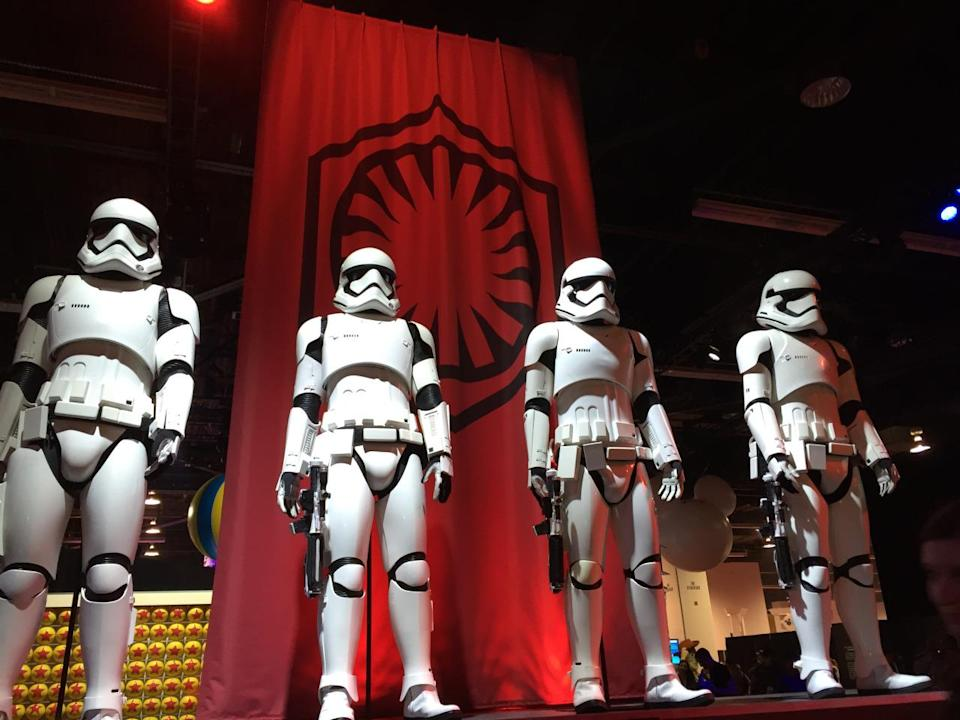 <p>Phasma's fellow foot soldiers are armed and dangerous, sporting a new look and striking a pose in front of the First Order banner, which hearkens to the old Empire symbol.</p>