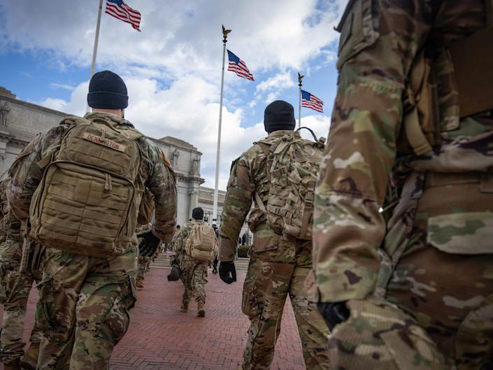 <p>Members of the National Guard march by Union Station during the inauguration of Joe Biden as US President in Washington, DC, on 20 January 2021</p> ((EPA))
