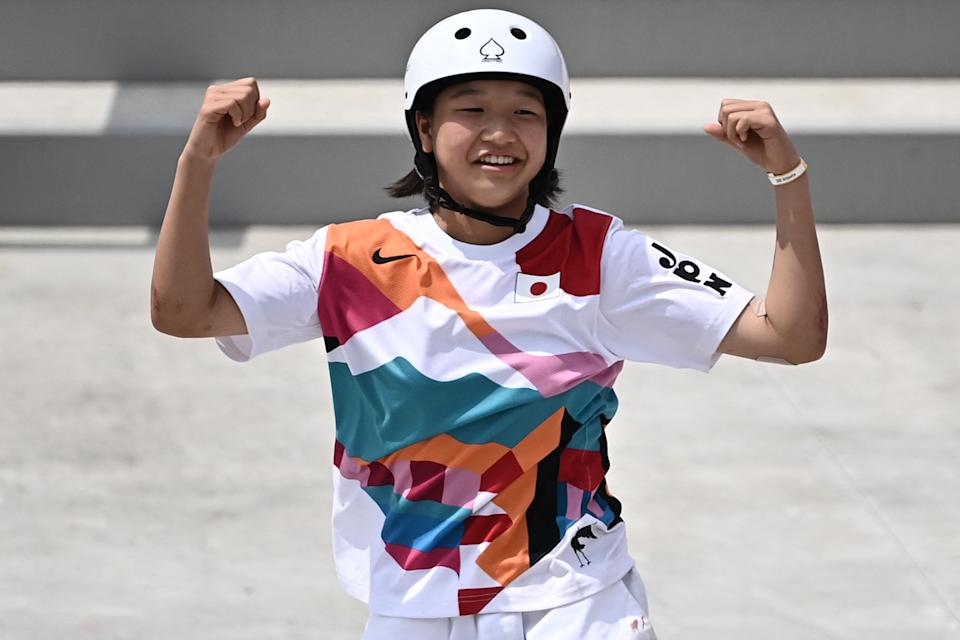 <p>Japan's Momiji Nishiya celebrates after performing a trick during the skateboarding women's street final of the Tokyo 2020 Olympic Games at Ariake Sports Park in Tokyo on July 26, 2021. (Photo by Lionel BONAVENTURE / AFP) (Photo by LIONEL BONAVENTURE/AFP via Getty Images)</p>