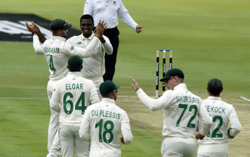 South Africa's Lungi Ngidi celebrates after getting his wicket, on day one of the first cricket test match between South Africa and Sri Lanka at Super Sport Park Stadium in Pretoria, South Africa, Saturday, Dec. 26, 2020. (AP Photo/Catherine Kotze)