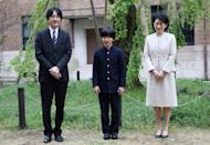 FILE PHOTO: Prince Hisahito, accompanied by his parents Prince Akishino and Princess Kiko, poses for photos at Ochanomizu University junior high school before attending the entrance ceremony in Tokyo