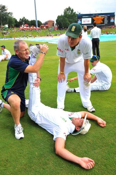 CENTURION, SOUTH AFRICA - DECEMBER 18: Jacques Kallis of South Africa stretches as Graeme Smith (R) looks on after day three of the 1st Test match between South Africa and India at SuperSport Park on December 18, 2010 in Centurion, South Africa (Photo by Duif du Toit/Gallo Images/Getty Images)