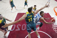 Italy's Stefano Tonut (7) drives to the basket past Australia's Dante Exum (11) during a men's basketball preliminary round game at the 2020 Summer Olympics, Wednesday, July 28, 2021, in Saitama, Japan. (Charlie Neibergall/Pool Photo via AP)