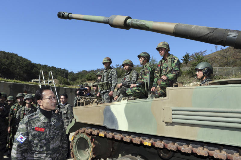 South Korean President Lee Myung-bak, left, visits marine base on Yeonpyeong Island near the Yellow Sea border with North Korea, South Korea, Thursday, Oct. 18, 2012. The island was bombarded in the North Korea's shelling attack in November 2010, leaving two South Korean Marines and two civilians dead.(AP Photo/Yonhap, Do Kwang-hwan) KOREA OUT