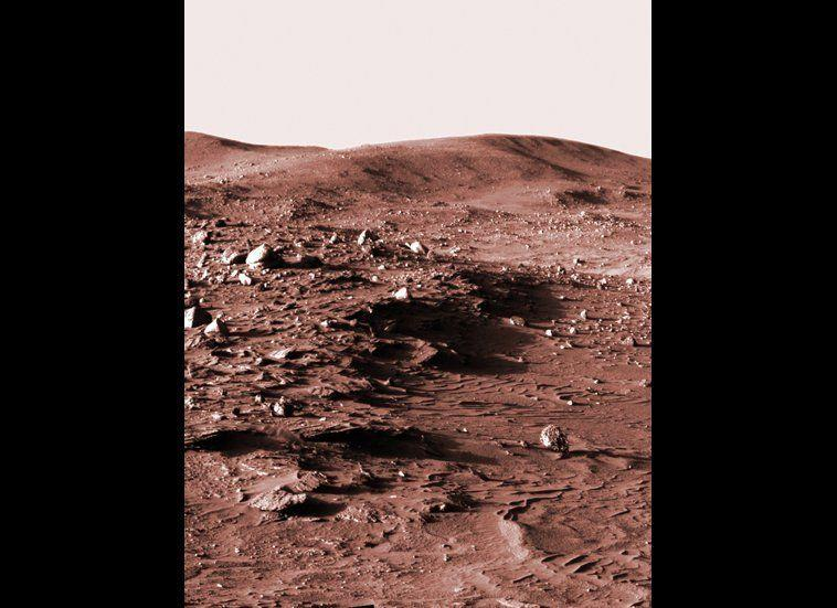 "This low-Sun panorama was shot from the Spirit Pancam, looking towards Husband Hill in the late afternoon of mission sol 813 (April 16, 2006). It seemed cooler to display the image in old-school sepia tones rather than plain old black-and-white. <em>From ""Postcards from Mars"" by Jim Bell; Photo credit: NASA/JPL/Cornell University</em>"