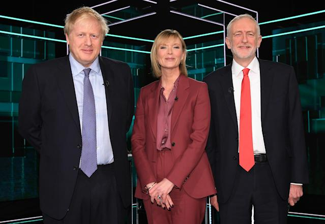 Boris Johnson and Jeremy Corbyn pose with ITV host Julie Etchingham. (Getty)