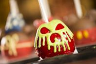 """<p><a href=""""https://www.disneysprings.com/shopping/disneys-candy-cauldron/"""" rel=""""nofollow noopener"""" target=""""_blank"""" data-ylk=""""slk:Disney's Candy Cauldron"""" class=""""link rapid-noclick-resp"""">Disney's Candy Cauldron</a> first opened in 1997 and since then, it's become a staple stop for park-goers every Halloween. At the Cauldron, you can get literally every type of candy apple and watch them make it right in front of you. </p>"""