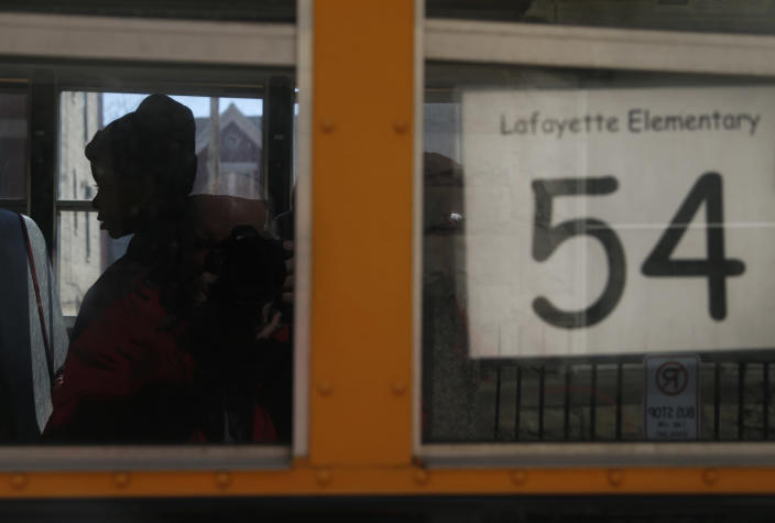 Special needs students board a bus at the Lafayette Elementary School in Chicago after school on Thursday, March 21, 2013, in Chicago. At Lafayette, a school in the Humboldt Park neighborhood where 95 percent of its 483 students come from low-income families, the principal read teachers a letter from the district Thursday saying the school is among those it plans to close under a contentious plan that opponents say will disproportionately affect minority students in the nation's third largest school district. (AP Photo/Charles Rex Arbogast)