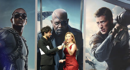 """Actress Scarlett Johansson gestures to the crowd during an interview at the UK premiere of """"Captain America: The Winter Soldier: at Shepherds Bush in London"""