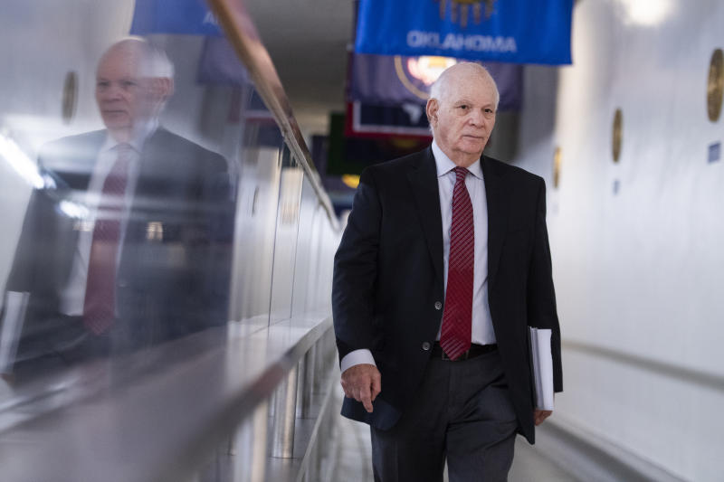 """UNITED STATES - APRIL 9: Sen. Ben Cardin, D-Md., speaks to a reporter in the Senate subway after he and Sen. Chris Van Hollen, D-Md., opposed more funds be added to the coronavirus response fund saying it wouldnt """"address the immediate need of small businesses, on Thursday, April 9, 2020. (Photo By Tom Williams/CQ-Roll Call, Inc via Getty Images)"""