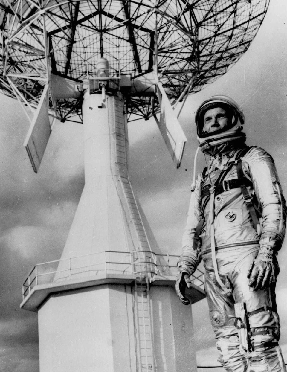 FILE- In this June 18, 1963, file photo, astronaut John Glenn, the first American to orbit the earth, poses before a Project Mercury tracking station at Cape Canaveral, Fla. Glenn's birthplace and childhood hometown in Ohio are celebrating what would have been the history-making astronaut and U.S. senator's 100th birthday with a three-day festival from July 16 through July 18, 2021. (AP Photo, File)