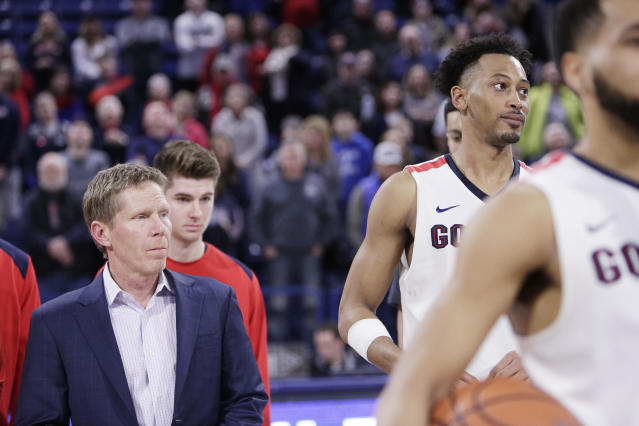 Gonzaga head coach Mark Few, left, and forward Johnathan Williams look on during senior day activities after an NCAA college basketball game against Pepperdine in Spokane, Wash., Saturday, Feb. 17, 2018. (AP Photo/Young Kwak)