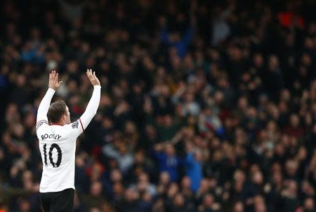 Manchester United's Rooney celebrates after scoring a goal against West Ham United during their English Premier League soccer match at the Boleyn Ground in London