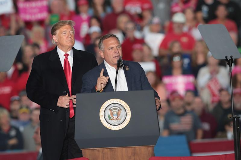 Republican Mike Bost who has twice narrowly won elections since 2014 rallies with President Donald Trump in Illinois last month