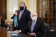 Senate Minority Leader Mitch McConnell of Ky., right, and Sen. Roy Blunt, R-Mo., arrive for a Senate Rules Committee hearing at the Capitol in Washington, Tuesday, May 11, 2021. (AP Photo/J. Scott Applewhite)
